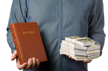 man holding bible and stack of money 425x282 | marketplace christianity
