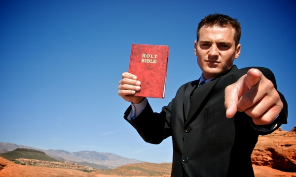 evangelist with bible pointing 600x360 | marketplace christianity